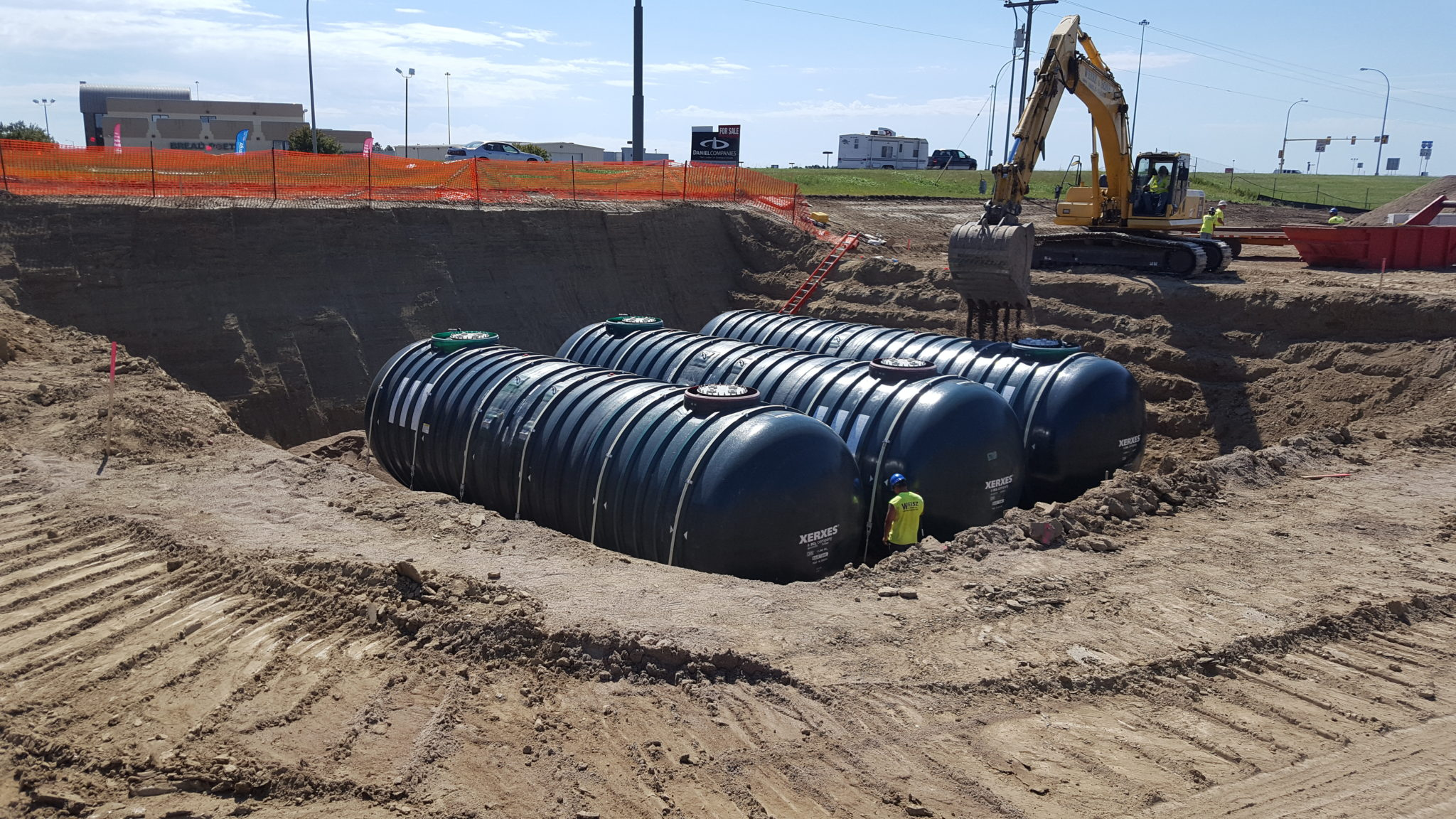 Tanks in ground with construction